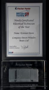 Kris' award certificate and glass trophy